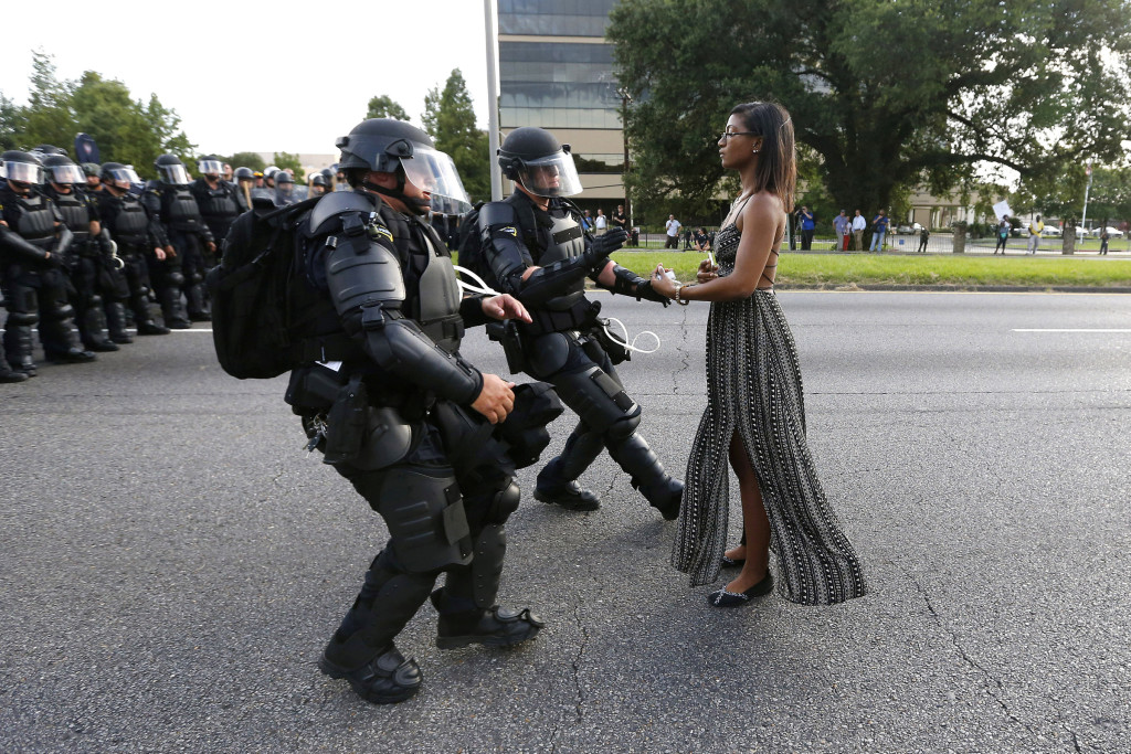 A protester is detained by Louisiana law enforcement near the headquarters of the Baton Rouge Police Department in Baton Rouge July 9. (CNS photo/Jonathan Bachman, Reuters)